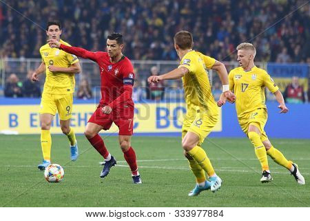 Kyiv, Ukraine - October 14, 2019: Cristiano Ronaldo Of Portugal (in Red) Attacks During The Uefa Eur