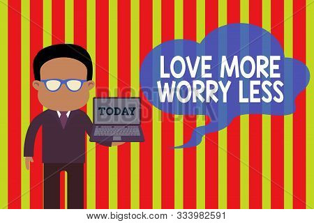 Handwriting text Love More Worry Less. Concept meaning Have a good attitude motivation be lovable enjoy life Standing man in suit wearing eyeglasses holding open laptop photo Art. poster