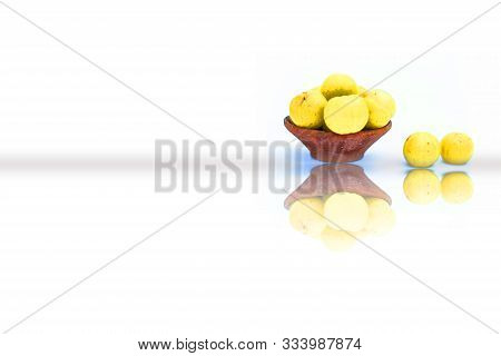 Raw Fresh Amla Or Indian Gooseberry In A Clay Bowl Isolated On White Along With Its Reflection.