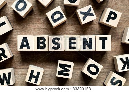 Letter Block With Word Absent On Wood Background With Another Alphabet As Frame