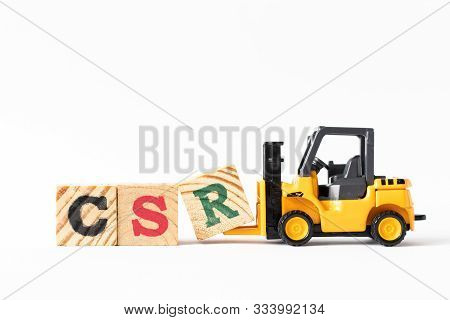 Toy Forklift Hold Wood Letter Block R To Complete Word Csr (abbreviation Of Corporate Social Respons
