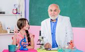 scientific biotechnology research. teacher of biology. Pupil girl in school lab. Microscopy. Laboratory equipment. science classroom. small girl with man tutor study chemistry. use magnifying glass poster