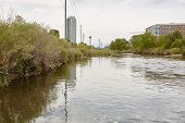 Condos and highrise buildings near Platte River at Confluence Park in the Riverfront Park neighborhood of Denver, Colorado poster