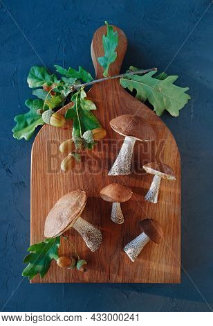 Autumn Composition. Forest Mushrooms On A Wooden Background. Flat Lay. Top View. Vertical Crop. Clos