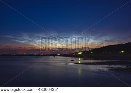 Reflection Of Noctilucent Clouds In The Water Of The Gulf Of Finland Of The Baltic Sea At Summer Nig