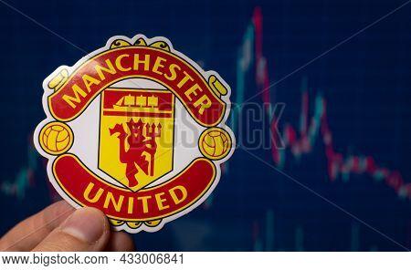 September 1, 2021 Manchester, Uk. Manchester United F.c. Football Club Emblem Against The Background