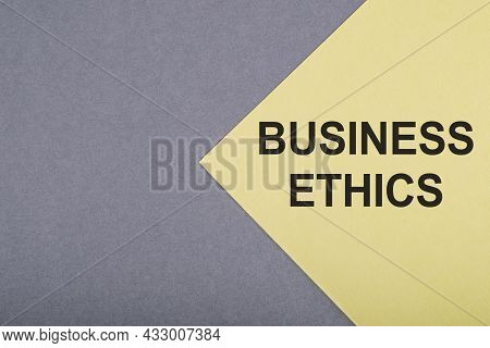 Business Ethics Text On Gray And Yellow Background.