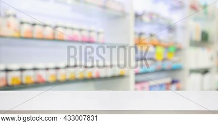 Pharmacy Drugstore Counter With Medicine And Vitamin Supplement On Shelves Blur Abstract Background