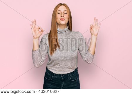 Young irish woman wearing casual clothes relax and smiling with eyes closed doing meditation gesture with fingers. yoga concept.