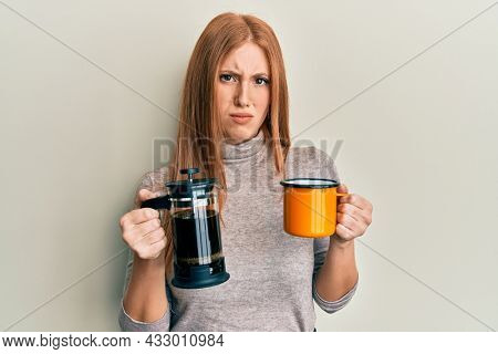Young irish woman drinking italian coffee skeptic and nervous, frowning upset because of problem. negative person.