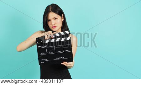 Black Clapper Board Or Movie Clapperboard In Woman's Hand.it Use In Video Production ,film, Cinema I
