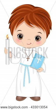 First Communion For Boy. Cute Girl Is Redheaded With Hazel Eyes Holding Holy Bible And Candle. Littl