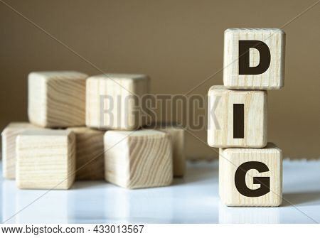 Dig - Acronym Nadrevyannye Cubes On A Brown Background. Business Concept