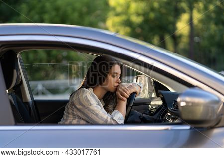 Depressed Young Woman Driver Sitting Inside Car, Feeling Doubtful Confused About Difficult Decision