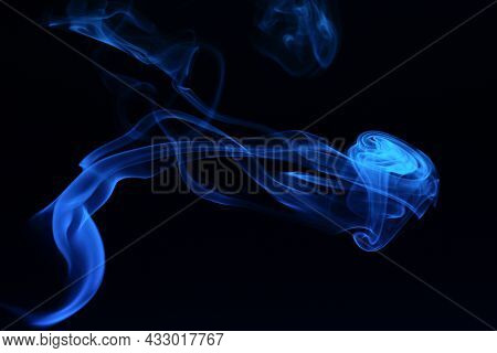 Abstract Colored Smoke Moves On Dark Background. Wallpaper. Personal Vaporizers Fragrant Steam. Conc