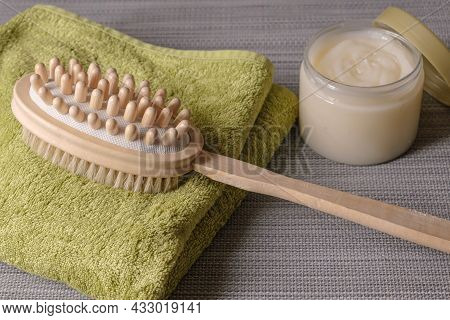 Double-sided Massage Brush For Body Brushing Lies On Towel On Background Body Scrub. Pins Of Natural