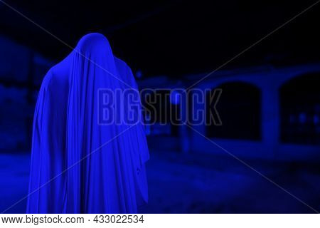 The Man Is In White Clothes And Shows A Scary Looking Face At A Creepy Old Building, Look Like Ghost