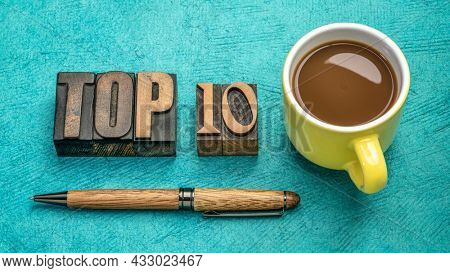 top 10 word abstract in vintage letterpress wood type with a cup of coffee, review and selection