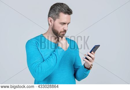 Serious Man With Beard Reading Sms On Smartphone, Sms