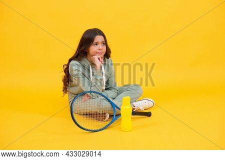 Teen Girl Going To Drink Water After Training. Badminton Player Relax. Healthy Active Lifestyle
