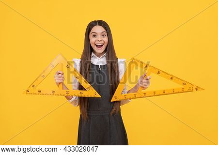 Child With Triangle. Angle Degree Measurement. Surprised Teen Girl Hold Ruler. Back To School.