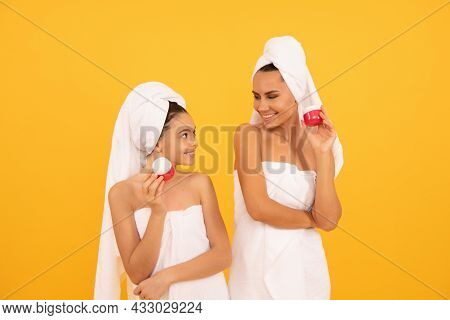 Family Spa. Mother And Teen Girl Hold Face Cream. Skincare. Relaxing Together. Beauty Treatment.
