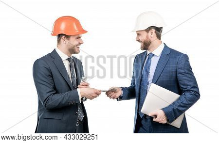 Investment In Architectural Project. Men Businessmen In Hardhat With Money And Laptop.