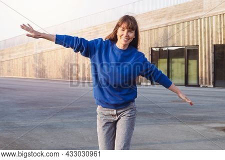 Smiling Cheerful Woman Running With Outstretched Arms.