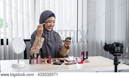 Asian Muslim Woman Beauty Blogger Tutorial By Eye Shadow Makeup On Her Eyes And Making Videos To Rev