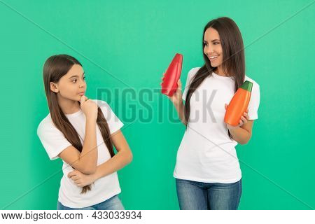 Mother Presenting Cosmetic For Teen Daughter. Suggest Shower Gel Or Shampoo Bottle.