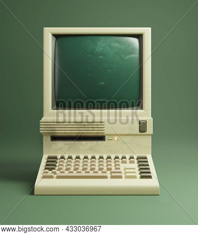 A Classic Desktop Computer From The 1980s, With Slightly Yellowing Beige Plastics And Monochrome Mon