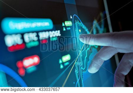 A Man Analysing Virtual Currency Price Charts On A Screen, Crytocurrency Investment Background.