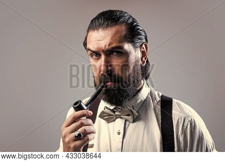 Masculinity And Charisma. Formal Male Smokier. Old Fashioned Bearded Hipster Smoking Pipe Trendy Man