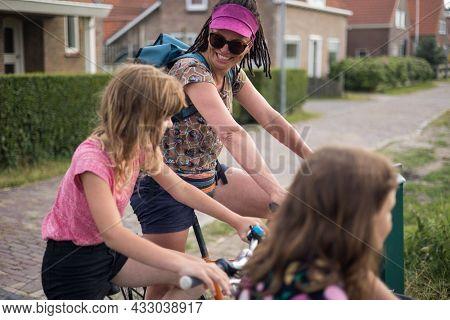 Mum with her children on bikes