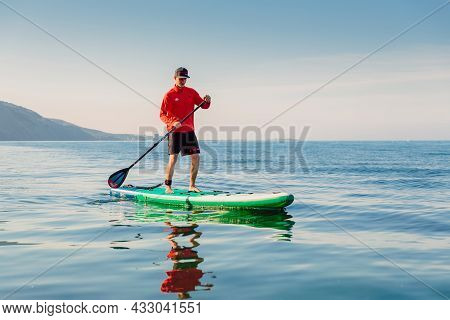 May 28, 2021. Anapa, Russia. Athletic Man On Stand Up Paddle Board At Ocean. Vacation On Sup Board I