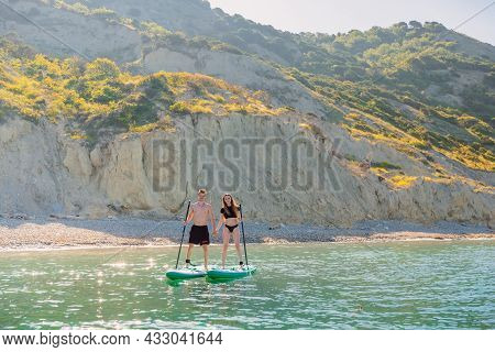 May 28, 2021. Anapa, Russia. Young Couple On Stand Up Paddle Board At Quiet Sea. People Vacation On