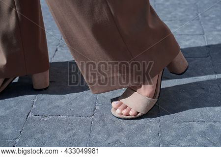 Beautiful Woman Feet After Pedicure Wearing High Heel Suede Sandals And Retro Style Bell-bottoms Fla