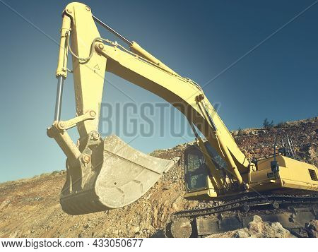 Excavator Scoop And Jib During Road Construction On The Rocky Soils. Heavy Machinery At Earthmoving,