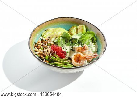 Healthy food - poke bowl with prawn, rice, fresh vegetables, edamame beans, soybean sprouts . Traditional dish Hawaiian cuisine. Poke bowl with shrimp isolated on white background. Salad prawn  bowl