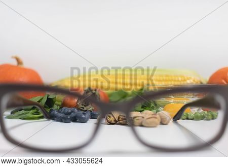 Close-up Of Glasses For Correcting Vision Against The Background Of Products For Improving Vision, H