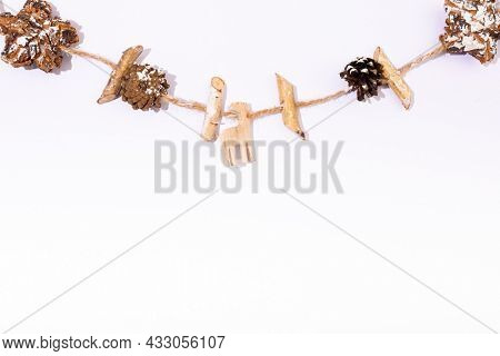 Composition of christmas decorations with pine cones and copy space on white background. christmas, tradition and celebration concept.