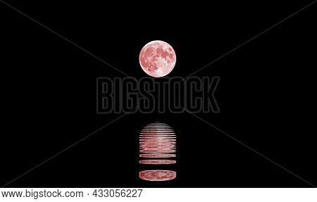 Reflection Of The Sea Water Of An Amazing Big Red Moon At Midnight And The Black Starless Sky In The