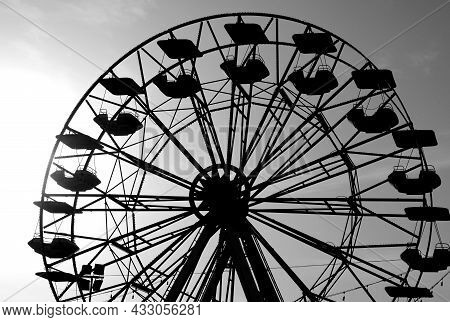 Ferris Wheel Of The Amusement Park With The Seats That Turn But Without People With Effect In White