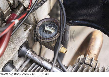 Oil Pressure Gauge Of The Opposed Carburetor Engine Of An Old Motorcycle, An Old Motorcycle Motor Cl