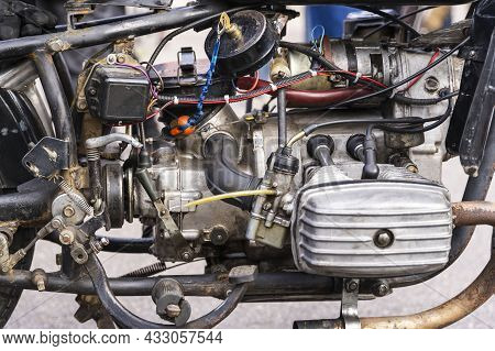 The Opposition Carburetor Engine Of An Old Motorcycle, Old Motor Of The Motorcycle Close Up.