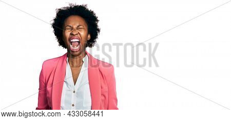 African american woman with afro hair wearing business jacket angry and mad screaming frustrated and furious, shouting with anger. rage and aggressive concept.