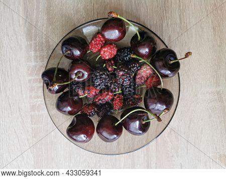 Fresh Black Mulberry Berries And Sweet Cherry