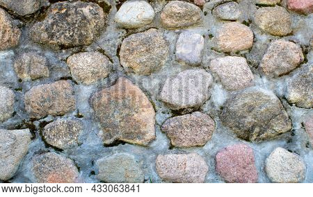 Stone Wall Texture. Mosaic Rocks Decorative Interior Wall Background. Masonry Wall Of Old Stones.