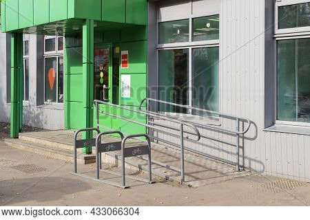 Empty Bicycle Parking Near Store With Slope Ramp For Moving People With Disabilities, In Summer