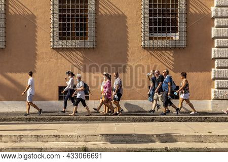 Rome, Italy - August 2, 2021: Tourist Guide Walks With The Menbers Of His Guided Tour Along A Walkwa